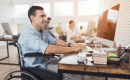 How do open plan offices affect employee communication?